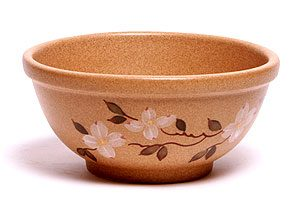 Hand painted ceramic pottery pasta bowl with a dogwood design